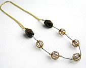 Brass cage & wooden beaded necklace