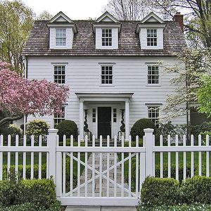 home exteriors - cape cod, cape cod home, white picket fence, cottage home,  Cape cod home features with white siding, gray shingles and por...