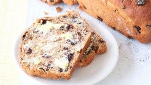 """Barmbrack is a traditional Irish sweetened bread. In Gaelic it's known as báirín breac, or """"speckled loaf"""" due to the way it is dotted with raisins."""
