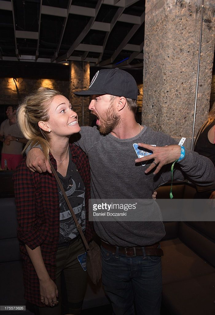 Lauren Parsekian and Aaron Paul attend the Lollapalooza 2013 after party at The Underground on August 3, 2013 in Chicago, Illinois.
