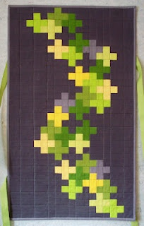 I love this chartreuse and gray combo.  And this design would look amazing with one of those Kona solids fat quarter bundles....