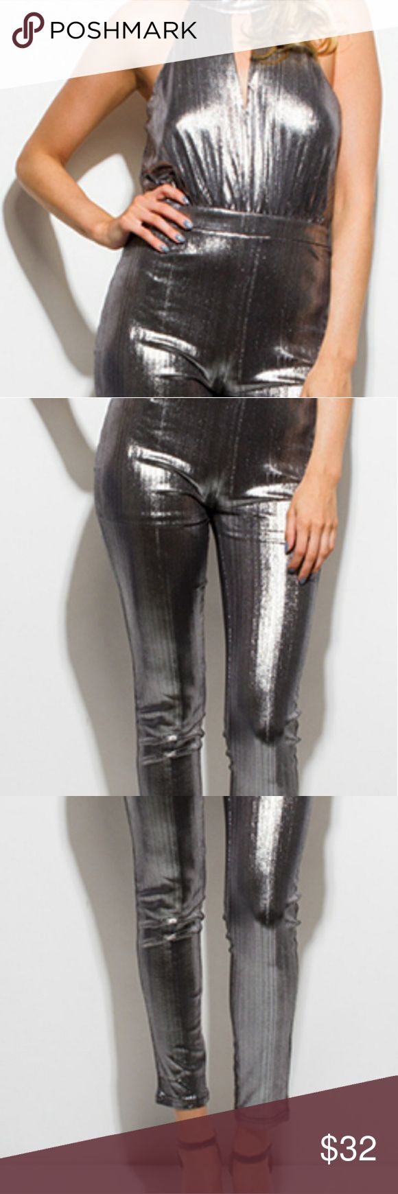XYAREN METALIC SILVER JUMPSUIT This jumpsuit is sure to turn heads. It has a key hole detal and goes with any occasion. Wear with black heels. Xtaren Pants Jumpsuits & Rompers
