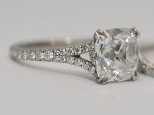 Antique style cushion cut diamond in split shank pavé setting