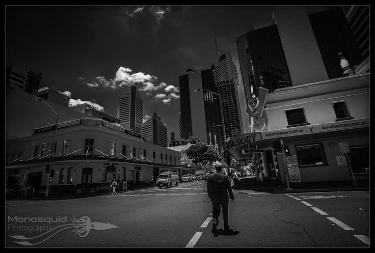 Street photo of businessman crossing the road - (c) Copyright Monosquid 2013, All rights reserved. Come join our facebook page where you can receive freebies, get tips and tutorials on photography and join in on a fun and positive photography community.  https://www.facebook.com/monosquidphotography