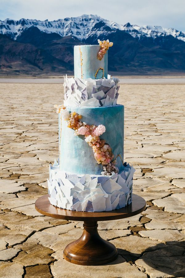 Created by Foxtail Bakeshop, this geology-inspired cake showcased shimmering gold veins, mica-like flakes, and a cascade of quartz clusters—all edible! The mesmerizing confection mirrored the mood of the landscape in which it was placed. | Photo by Gallivan Photo
