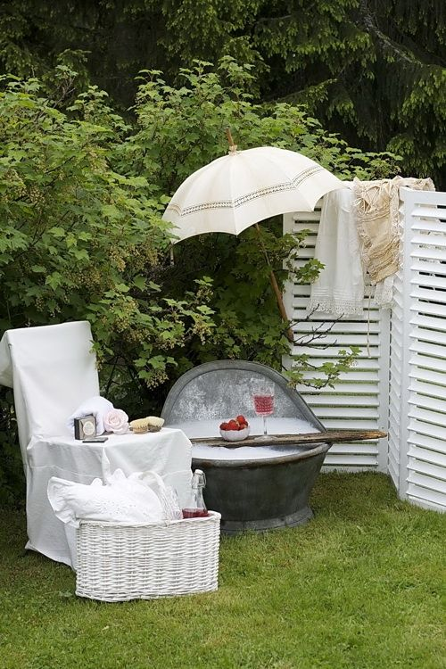 A delightful outdoor bath with wine and strawberries. No one will see...it is in the country.