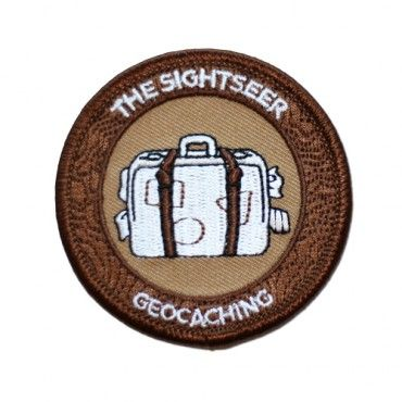"""7SofA Patch: The Sightseer $4.00 USD  Are you your own Travel Bug®? Is your profile page plastered with photos of you exploring the 7 Wonders of the World? Is it geocaching instead of a guidebook that shows you all the locals' favorite spots?  If this sounds like you or someone you know, celebrate with this cool Sightseer patch!  Find a Multi-Cache to earn the Sightseer souvenir.  Size: 2.5"""" (6.3cm) in diameter"""