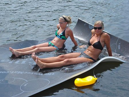 WaterMat Allows Walking, Jumping, Sliding Over Water! This woud be worth purchasing for days on the lake.