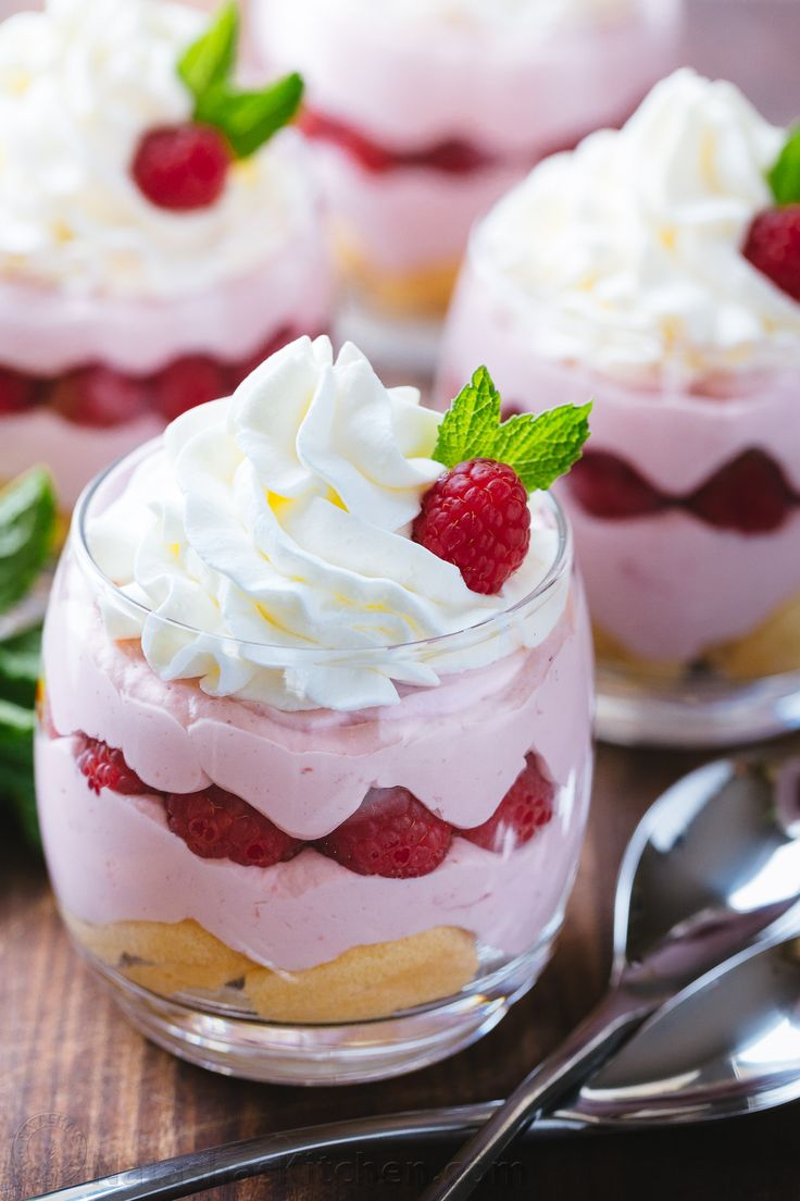 Raspberry Mousse Cups - an easy and impressive dessert and always a hit at parties! The sweet/tart raspberry mousse is bursting with fresh raspberry flavor.