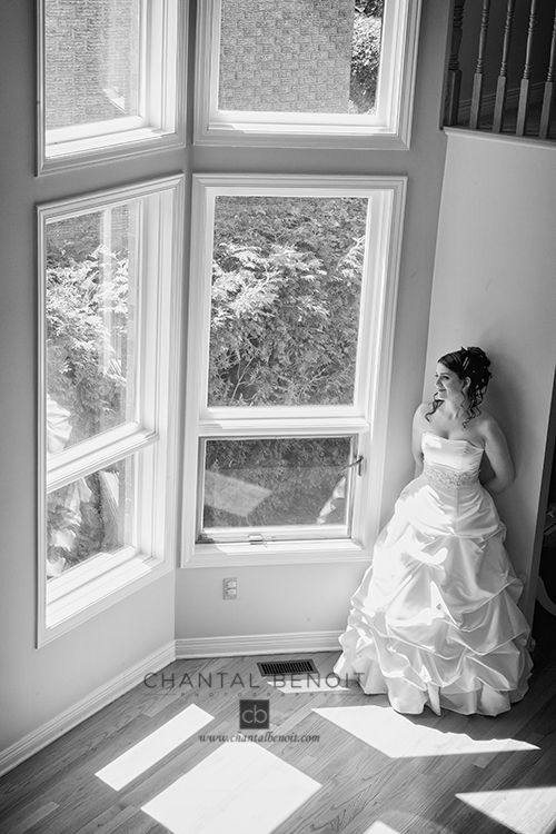 Black and white photo of bride reflection on her wedding day