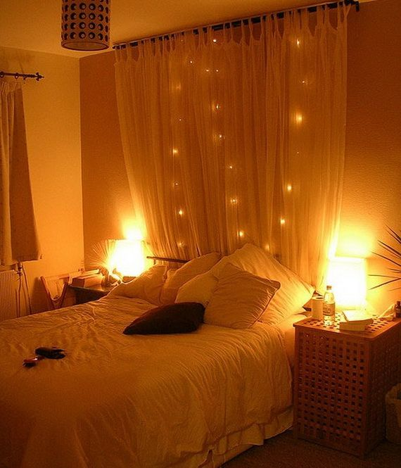 hang a curtain behind a bed with string lights cute and easy diy headboard minus the string lights for me but basement bedroom savvy