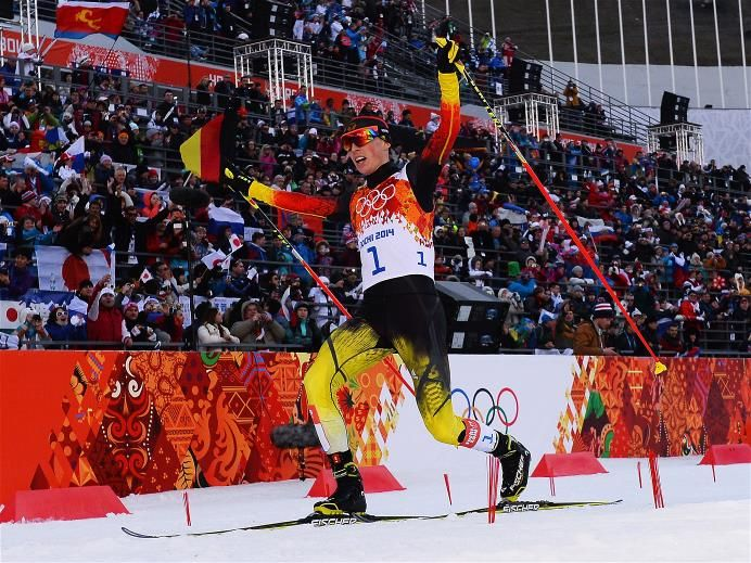 Eric Frenzel of Germany celebrates as he wins the gold medal during the Nordic Combined Individual Gundersen Normal Hill and 10km Cross Country