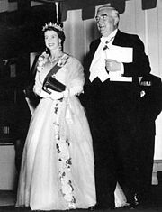 Queen Elizabeth II with Prime Minister Robert Menzies at an official function during her first visit to Australia. (16 February 1954)    National Archives of Australia, accession number M2127