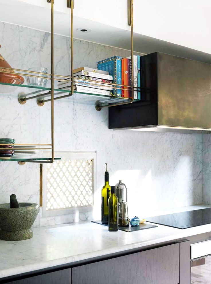 Brass and glass kitchen shelf