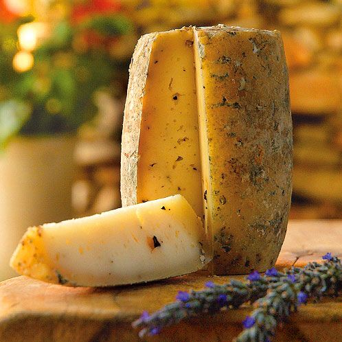 Peppered Caprainho. An organic goat cheese aged with whole pepper granules.