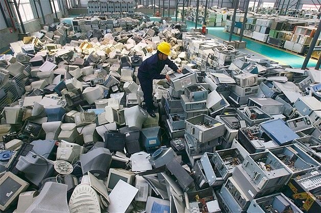 Image: Discarded computers (© Stringer/Reuters) An employee sorts discarded computers at a newly opened electronic waste recycling factory in Wuhan, China. According to the US Environmental Protection Agency, e-waste is the fastest growing commodity in the waste stream, with a growth rate five times that of other parts of the business.