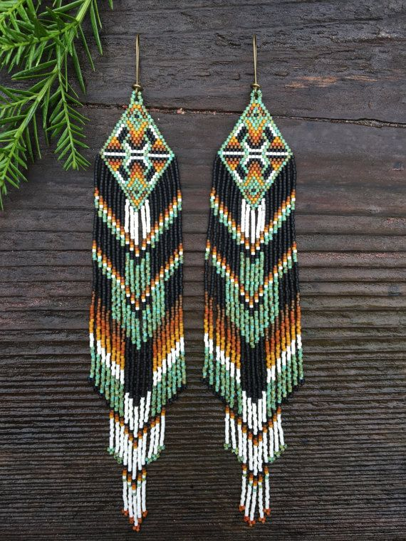 ✨⚪️High Desert Collection⚪️✨ These one of a kind intricately beaded earrings took many hours to create and were made with love, intention, and patience. Constructed of the highest quality glass seed beads. Brass kidney style ear hooks allow for those with regular pierced and gauged ears to wear them effortlessly. (For those with metal allergies, please see my shop section titled hypoallergenic ear hooks to purchase a gold filled option). 8 1/2 inches long