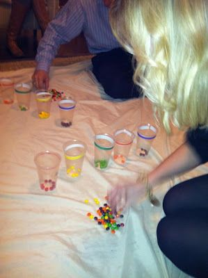 Minute to win it style activity for cub scouts - using only a straw, sort and place skittles or M&Ms into cups by color.