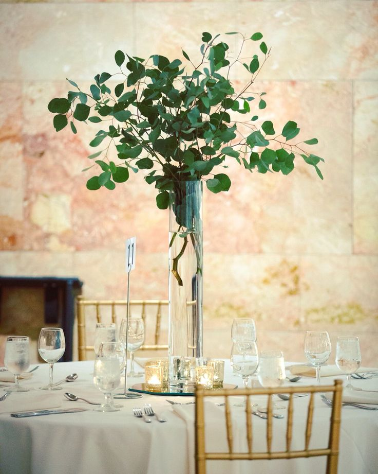 Tall silver dollar eucalyptus centerpieces from the wedding reception at the VMFA Marble Hall : Worthington Photography