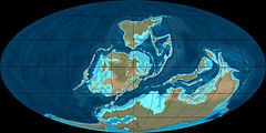 Devonian: geologic period and system of the Paleozoic Era spanning from the end of the Silurian Period (about 419 may) to the beginning of the Carboniferous Period (about 358 mya); named after Devon, England, where the rocks from this period were first studied; 1st significant adaptive radiation of terrestrial life; no large vertebrate terrestrial herbivores yet, but free-sporing vascular plants spread across dry land, extensive forests