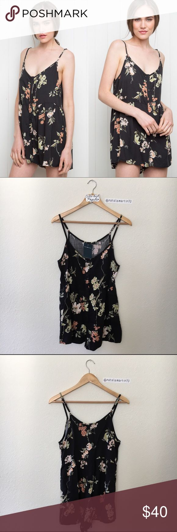 BNWT Brandy Melville Black Lilly Kimia Romper BNWT. Super cute floral print. Adjustable straps. Comes with free Brandy stickers.   🌸 I only sell on Posh 🌸 I don't trade 🌸 My price is FIRM! I won't be accepting any offers Brandy Melville Other