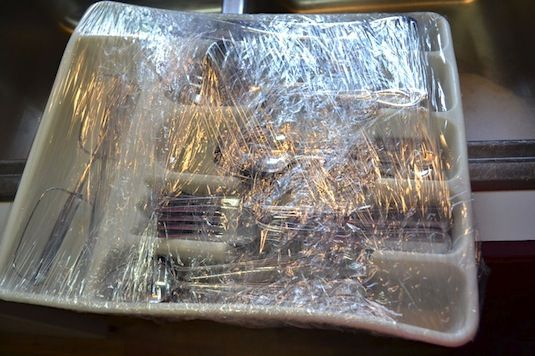 33+ Helpful Moving Tips Everyone Should Know ~ Use plastic wrap to keep items in their place!
