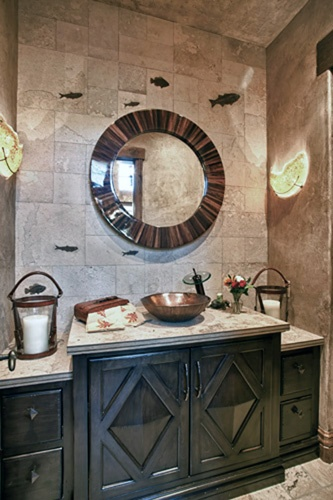 Don't like the Fossils in the Wall but like Copper Sink, Waterfall Faucet, Cabinet & Glass Sconces in this fun rustic bathroom.
