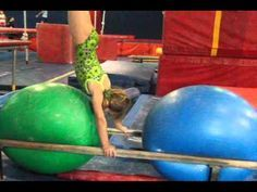 Using Physio balls to bounce into handstands on the parallel bars - gymnastics drill.