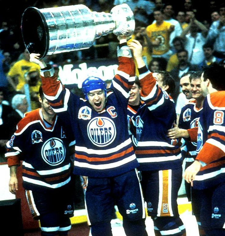 Mark Messier hoists the Stanley Cup at the old Boston Garden after the Oilers captured their fifth NHL championship with a Game 5 victory in the 1990 Final.