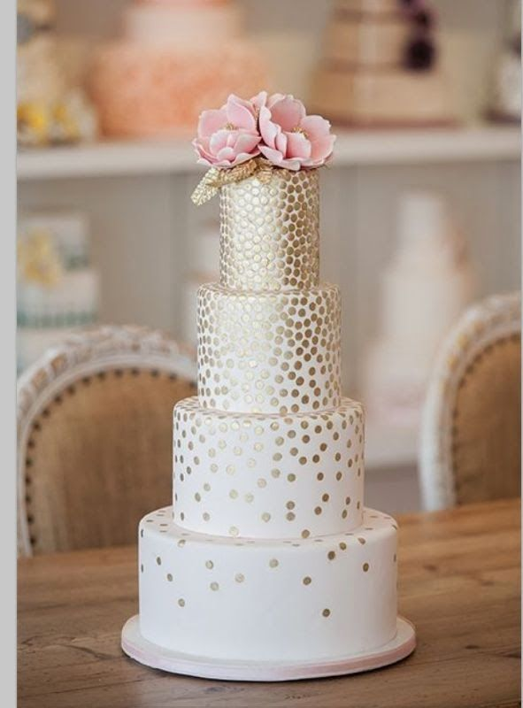 Golden wedding cakes... Geometric. Falling gold dots really makes this a dreamy geometric golden cake.