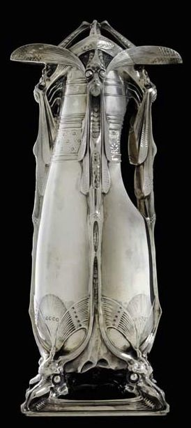 CARLO BUGATTI A Rare and Important Silver Claret Jug, circa 1907, modeled with a dragonfly and grotesque motifs, executed by A.A. Hébrard, 15 3/8 in. (39 cm.) high, 7 1/2 in. (19 cm.) wide