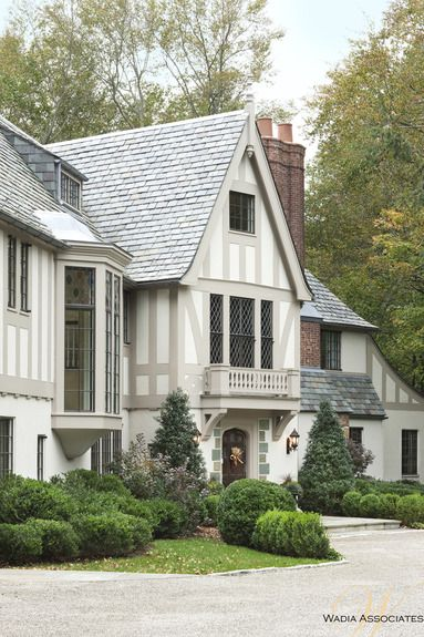 Love the soft grey and white over the brown and cream usually seem on Tudor houses.