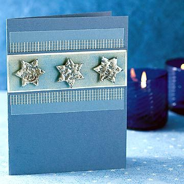 Dimensional six-pointed stars help this Hanukkah greeting card stand out. Crafted in card stock, embossing powder, and plastic mesh, this project can be completed in short order.