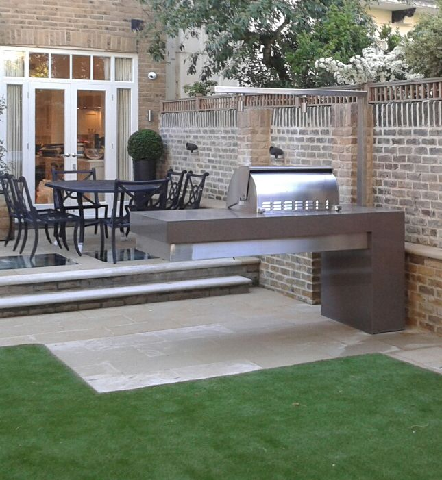 Granite-clad cantilevered barbecue, London. By Jo Thompson Garden Design