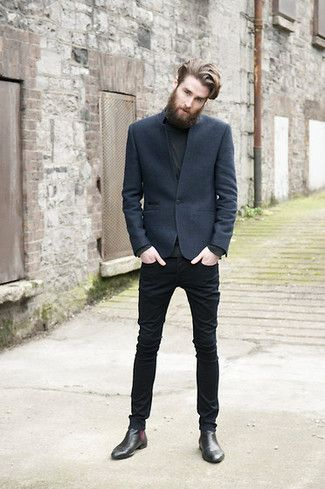Dress in a charcoal sportcoat and black slim jeans for a dapper casual get-up. Black leather chelsea boots will add elegance to an otherwise simple look.