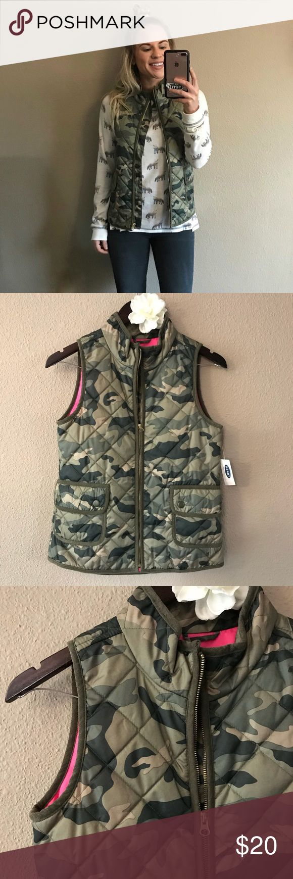 NWT Girls Old Navy Camouflage Puffer Vest New with tags. Old Navy KIDS (Girl) size XL (14). Camouflage puffer vest with pink lining. Two buttons on the front with 2 button snap closure. Gold zipper details. I'm typically an XS/S and purchased this for myself but never ended up wearing it. Old Navy Jackets & Coats Vests
