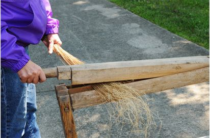 Flax Break..A flax break is a set of intersecting wooden blades that force the retted flax straw to snap into short sections which then fall away from the fibers.