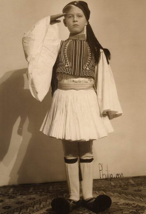 Another shot of Prince Philip in Greek clothing, foreshadowing his military career with his salute and determined expression.