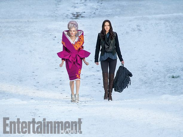 XASGTRFCDSVFHGBUKABJGSGB!!!!!!! I'm freaking out right now with the new stills...holy shit...Effie looks like a present. Which this pic is. To us. Omg. Again with some apparent Asian influence... It looks as if they're trekking badassly across a desert, but that's gotta be snow. 'The Hunger Games: Mockingjay - Part 2': 8 EW exclusive photos | Elizabeth Banks and Jennifer Lawrence | EW.com
