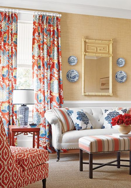 Orange and navy decor in a living space... the complimentary colors work well in this room without bogging it down from too much color or the brightness. Good ideas! /ES