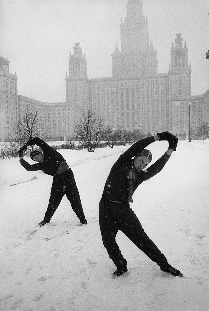 Marc Riboud - I'm not entirely sure what is going on but it looks like they're stretching? I wonder if this was staged at all but it's an effective shot that grabbed my attention. The dark clothing works well as it's what I look at first.