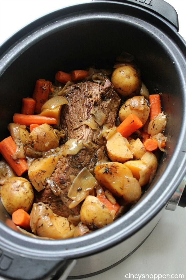 Slow Cooker Pot Roast - loaded with potatoes, carrots, and onions, this is an easy slow cooker idea that makes for a filling meal.