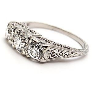 A simply gorgeous antique engagement ring featuring a stunning 1/2 carat I/VS2 round old European cut diamond solitaire. The setting has intricate filigree and the shoulders have fine wheat and mill grain details. This certified ring is crafted of solid 18k white gold and dates from the 1930's.
