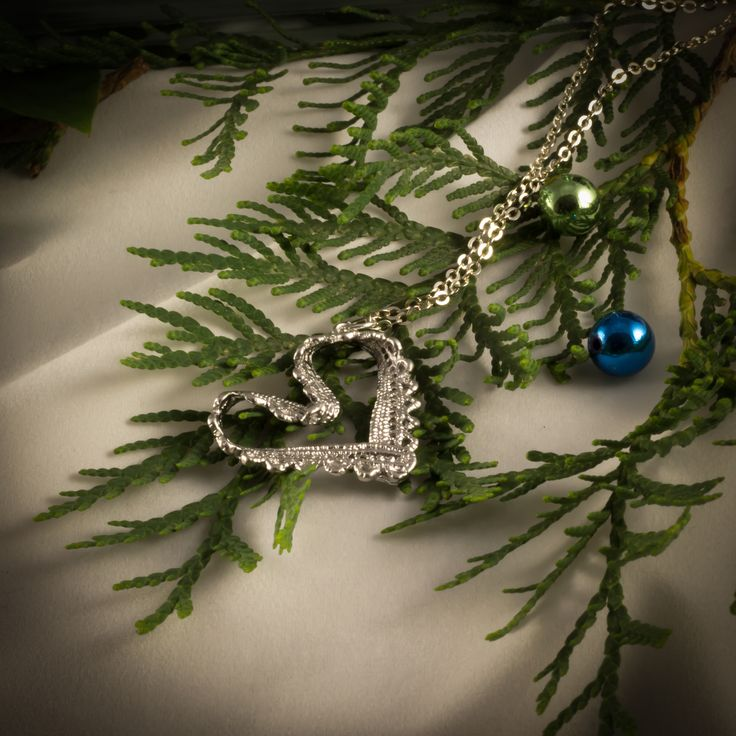 Lace heart necklace: This necklace features a lace heart pendant, made with silver plating over pewter. A beautiful gift to be opened by someone you love on Christmas morning. 0614933NSP