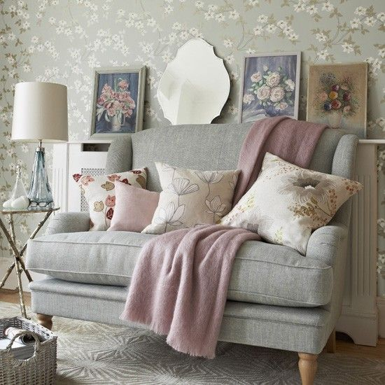Grey and pink living room  Grey and pink is a perfect colour combination. Here, a delicate floral wallpaper is the perfect backdrop for layering up pastel-coloured cushions, throws and even some quirky artwork.    Read more at http://www.housetohome.co.uk/room-idea/picture/pastel-colour-schemes-10-of-the-best/2#0JFby28RcClWgjti.99