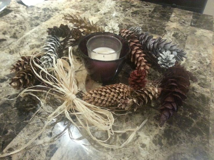 Made a wreath out of pinecones I found....painted them up, tied a Raffia bow and presto! .....a decoration for the table.