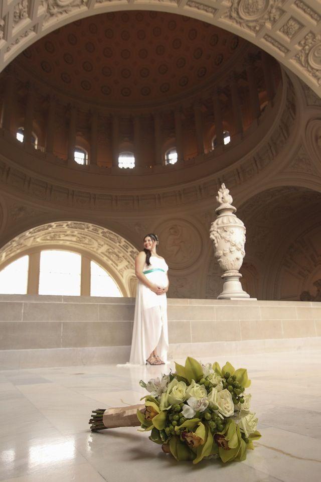 The bride looks gorgeous on her maternity wedding dress. #sanfranciscocityhallphotographer #maternitywedding #sfcityhallwedding www.rachellevinephoto.com