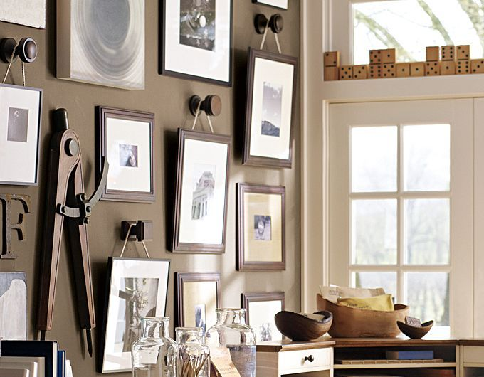 #potterybarn - Hanging picture frames on the wall with cute knobs, adorable.