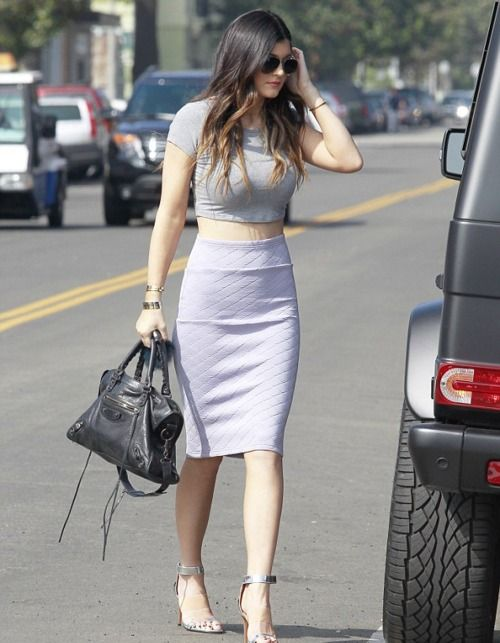 Shop Kylie Jenner's look for $129:  http://lookastic.com/women/looks/grey-cropped-top-and-black-shopper-handbag-and-silver-sandals-and-white-pencil-skirt/1091  — Grey Cropped Top  — Black Leather Shopper Handbag  — Silver Sandals  — White Quilted Pencil Skirt