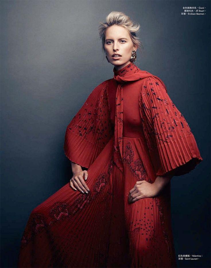Wearing red, Karolina Kurkova poses in Valentino dress and Saint Laurent earrings
